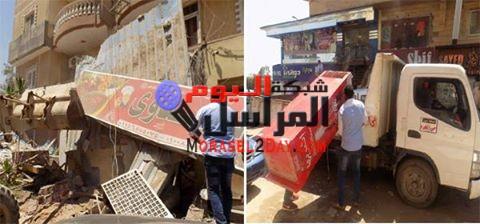 ازالة 7 محلات ورفع إعلانات غير مرخصة فى حملة اشغالات بمحافظة الجيزة