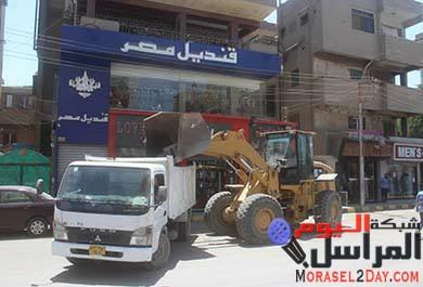 بالصور رفع 95 حالة إشغال بشوارع ببني سويف